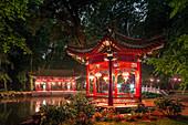 Royal garden in Warsaw, called Lazienki Krolewskie, Chinese garden during evening, Warsaw,  Mazovia region, Poland, Europe