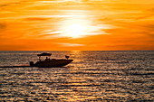 Sunset tour with a pleasure boat in the Gulf of Mexico, Fort Myers Beach, Florida, USA