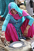 2015, Nandgoan / Nandagram, Vrindavan, Uttar Pradesh, India, woman doing chapatis