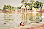 2017, Pavan Sarovar Nandgoan / Nandagram, Vrindavan, Uttar Pradesh, India, The Brahmin Krishna Murari Goswami having a bath in the holy seaside resort Pavan Sarovar in the place of residence Krishna