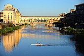 Two oarsmen in front of the Ponte Vecchio on the Arno River, Florence, Toscana, Italy