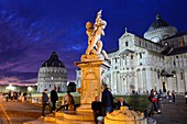 Battistero, Duomo and leaning tower in the evening light with tourists, Pisa, Toscana, Italy