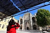 Woman photographs at the Saint Maximin Cathedral, Provence, France