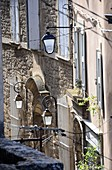 Medieval houses and lanterns in the upper town, Bonnieux in the Luberon, Provence, France