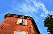 Red house and blue sky in Roussillion in the Luberon, Provence, France