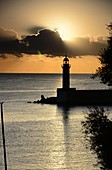 Sunrise view of the sea with harbor with lighthouse, Bastia, North Corsica, France