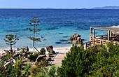 Rocks and bar on Agosta beach in the bay of Ajaccio, western Corsica, France