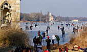 Winter fun on the Holy Lake, Gothic library and view to the Marble Palace, Potsdam, Brandenburg, Germany