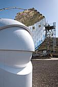 View of the MAGIC mirror telescope with a small telescope in the foreground, Roque de los Muchachos, Caldera de Taburiente, La Palma, Canary Islands, Spain, Europe