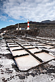 View of the salt flats, in the background the lighthouse of Fuencaliente, La Palma, Canary Islands, Spain, Europe