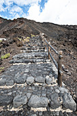 Stone stairs to Echentive beach, in the background the Teneguia volcano, La Palma, Canary Islands, Spain, Europe
