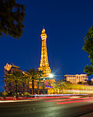 Eiffel Tower of the Hotel Paris on the Strip in Las Vegas at night, USA