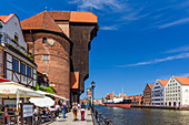 """Gdansk, Main City, old town, old motlawa canal. Gothic crane, branch of the National Martime Museum. The ship-museum """"Soldek"""", dockyard setting for reconstructed 17th-century granaries, housing modern national maritime museum. Gdansk, Main City, Pomorze region, Pomorskie voivodeship, Poland, Europe\n"""