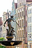 Gdansk, Main City, old town, fountain of Neptune, Dlugi Targ street (Long Market). Gdansk, Main City, Pomorze region, Pomorskie voivodeship, Poland, Europe