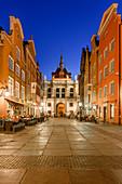 Gdansk, Main City, old town, Dluga (Long) street, Golden Gate, behind roof of former prison and torture chamber. Gdansk, Main City, Pomorze region, Pomorskie voivodeship, Poland, Europe