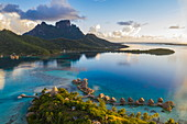Aerial of Sofitel Bora Bora Private Island Resort with overwater bungalows in Bora Bora Lagoon with Mount Otemanu at sunrise, Vaitape, Bora Bora, Leeward Islands, French Polynesia, South Pacific