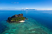 Aerial of Vomo Lai Lai Island with islands of the Yasawa Group in the distance, Little Vomo Island, Mamanuca Group, Fiji, South Pacific