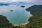 Overhead of sailboats in bay with expedition cruise ship World Explorer (nicko cruises) at anchor, Paraty, Rio de Janeiro, Brazil, South America