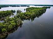 Aerial of two kayaks amidst islands on Newboro Lake, near Newboro, Ontario, Canada, North America