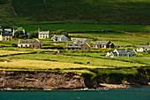 Houses and rocks on the Atlantic coast at Feohanagh, County Kerry, Ireland
