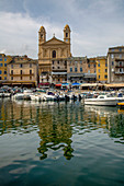 Boats moored in the port at Bastia with St. Jean Baptiste church, Bastia, Corsica, France, Mediterranean, Europe