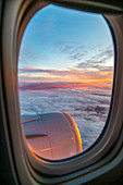 Generic view from airplane window of sunrise over England, United Kingdom, Europe