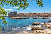 Harbourside view of Dubrovnik Old Town, UNESCO World Heritage Site, and Adriatic Sea, Dubrovnik, Dalmatia, Croatia, Europe