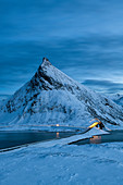 Fredvang Bridge set against pyramid shaped mountain at night with light trails, Lofoten, Arctic, Norway, Europe