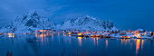 Panoramic of Reine fishing village at night in winter, Reinefjord, Moskenesoya, Lofoten, Arctic, Norway, Europe