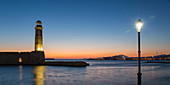 Panoramic view across entrance to the Venetian Harbour, dawn, lighthouse prominent, Rethymno (Rethymnon), Crete, Greek Islands, Greece, Europe