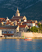 View to the Old Town at sunrise, ferry sailing into harbour, Korcula Town, Korcula, Dubrovnik-Neretva, Dalmatia, Croatia, Europe