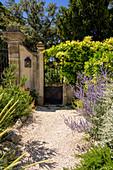 Summer garden gate, Occitania, France