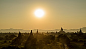 Sunset over stupas of temples in Bagan, Myanmar.