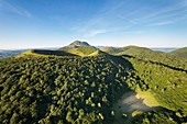 France, Puy de Dome, area listed as World Heritage by UNESCO, the Regional Natural Park of the Volcanoes of Auvergne, Chaine des Puys, Orcines, the Puy Pariou volcano, the Puy de Dome volcano in the background (aerial view)