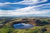 France, Puy de Dome, Picherande, Parc Naturel Regional des Volcans d'Auvergne (Natural regional park of Volcans d'Auvergne), Cezallier, Chauvet lake, volcanic maar lake (aerial view)
