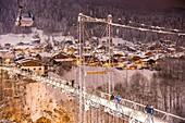 France, Haute-Savoie, Morzine, the valley of Aulps, ski slopes of the Portes du Soleil, cable car of Super Morzine and footbridge François-Baud, suspension bridge and footbridge for pedestrians finished in 1952