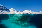 Above and below view of glacial ice near Wiencke Island, Neumayer Channel, Antarctica, Polar Regions
