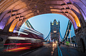 Lights on Tower Bridge over the River Thames with a typical double decker bus, London, England, United Kingdom, Europe