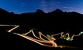 Star trail on the lights of car trace at Stelvio Pass, Valtellina, Lombardy, Trentino Alto Adige, Italy, Europe