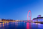 London Eye illuminated at night with view of the River Thames, London, England, United Kingdom, Europe
