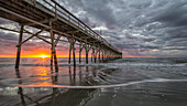 Beach, ocean, waves and pier at sunrise, Sunset Beach, North Carolina, United States of America, North America