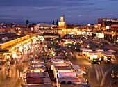View over Djemaa el Fna at dusk with foodstalls and crowds of people, Marrakech, Morocco, North Africa, Africa
