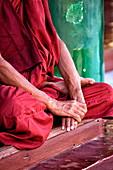Hands of Buddhist monk at Shwedagon Paya (Shwedagon Pagoda), Yangon (Rangoon), Myanmar (Burma), Asia