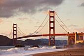 The Golden Gate Bridge, linking the city of San Francisco with Marin County, taken from Baker Beach at sunset and high tide, San Francisco, California, United States of America, North America