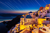 Oia village and churches with star trails after sunset, Santorini (Thira), Cyclades Islands, Greek Islands, Greece, Europe