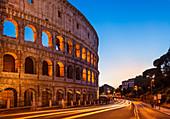 Rome Colosseum (Flavian Amphitheatre) at night with light trail, UNESCO World Heritage Site, Rome, Lazio, Italy, Europe