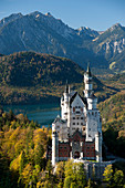 Romantic Neuschwanstein Castle and German Alps during autumn, southern part of Romantic Road, Bavaria, Germany, Europe