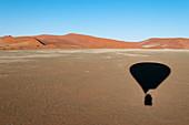 Hot air balloon shadow on desert, Namib Naukluft Park, Namib Desert, Namibia, Africa