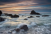Sunset over sea stacks and surf, Ecola State Park, Oregon, United States of America, North America