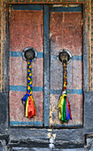 Intricate decorations on a doorway at Thiksey monastery (gompa), Ladakh, Himalayas, India, Asia